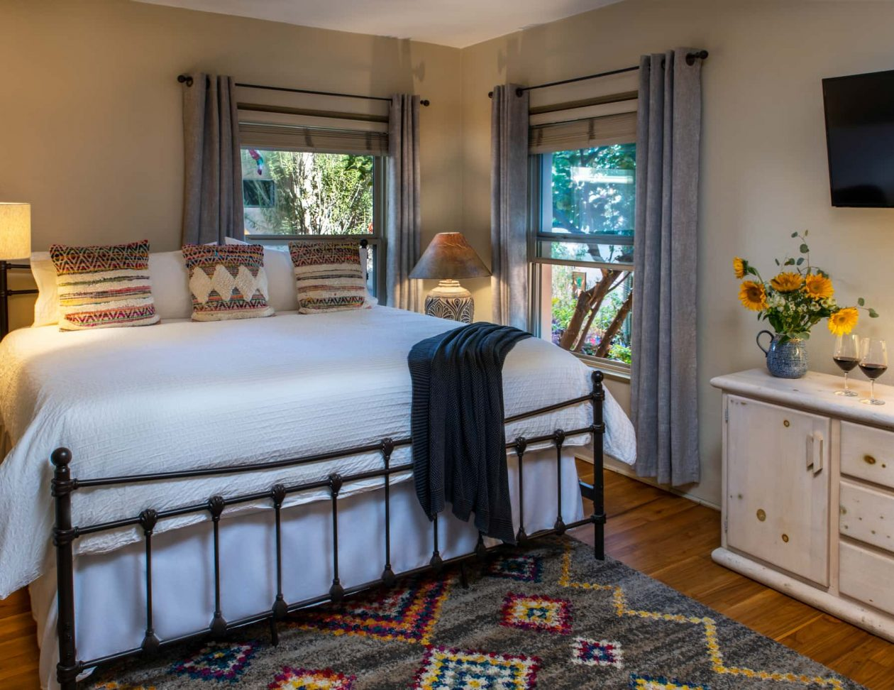 King bed in the Sam Hughes room at the Adobe Rose Inn