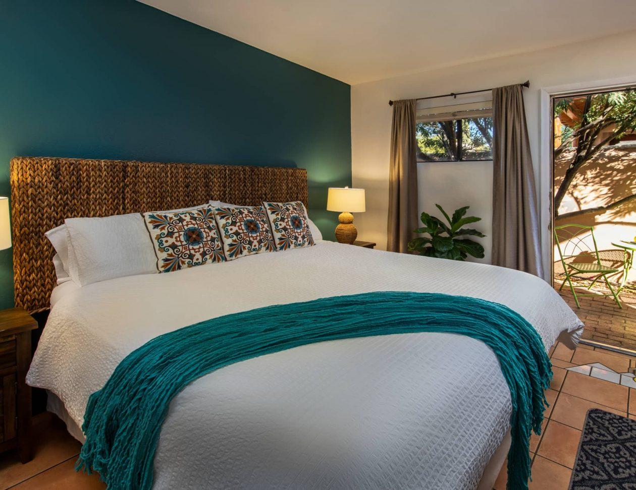 King bed in the Santa Catalina Room at Adobe Rose Inn