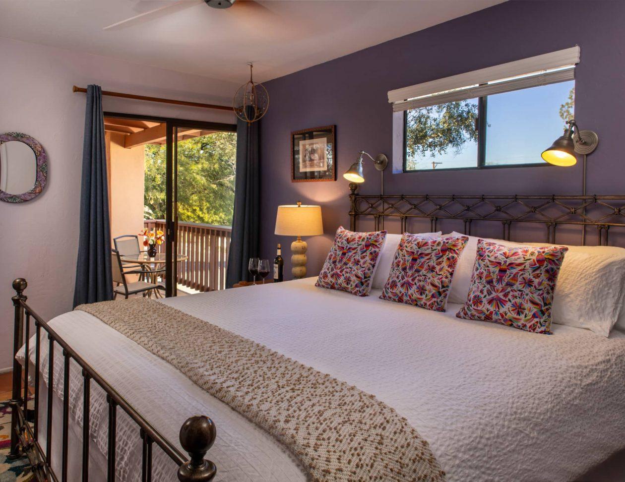 King sized bed in the Santa Rita Suite at Adobe Rose Inn