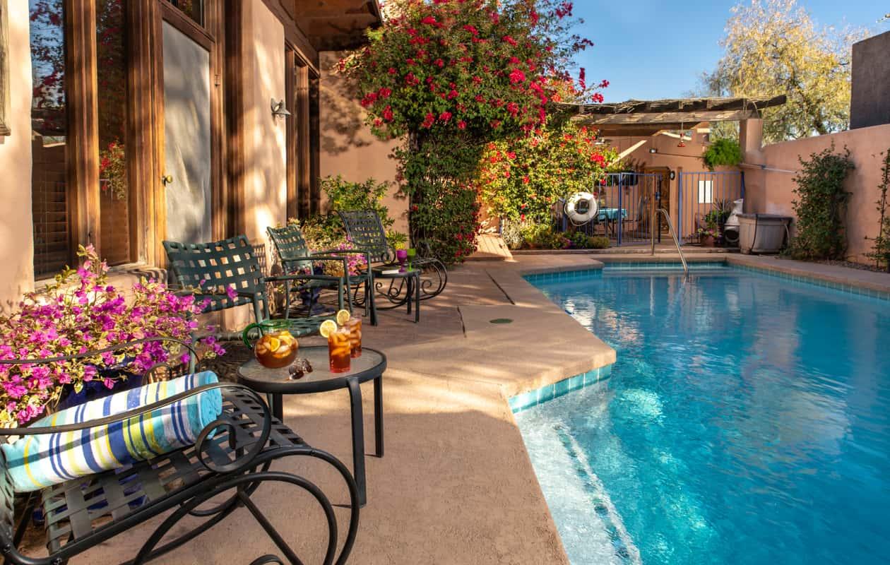 Sit poolside at Adobe Rose Inn