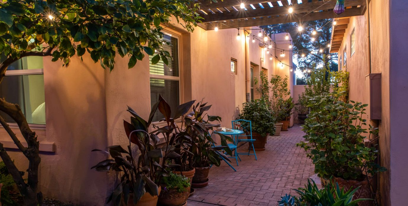 Exterior pathway and patio at Adobe Rose Inn