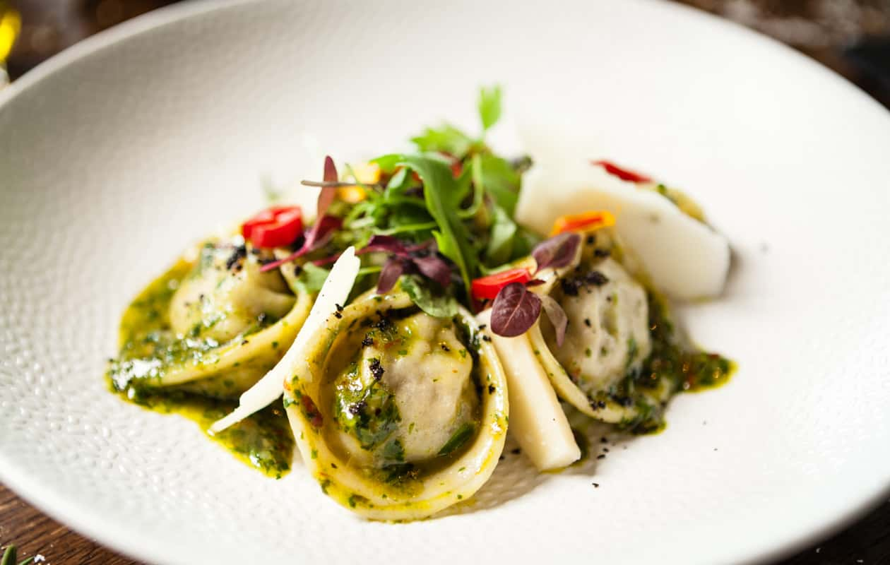 House made ravioli served with micro greens and a pesto