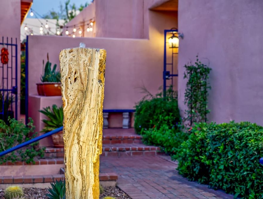 A water fountain sculpture at the entrance to Adobe Rose Inn